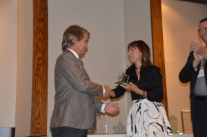 Jeff Cook of Beringia Community Planning receives the award from Canadian judge Maria DeBruijn.